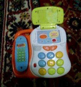 Игрушечный телефон.