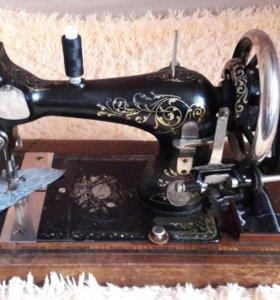Швейная машинка зингер..