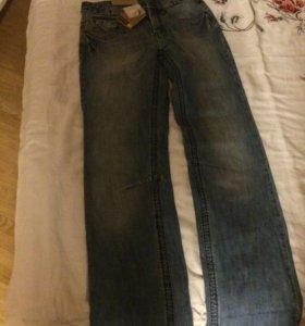 Новые джинсы с этикетками