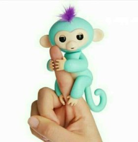Игрушка ручная обезьянка