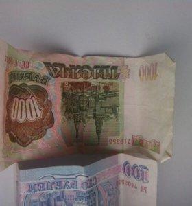 Советские купюры номиналом 1000 и 100 рублей