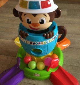 Интерактивная игрушка обезьянка в бочке Bright sta