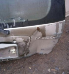 дверь багажника на т надия 98г с небольшим дефекто