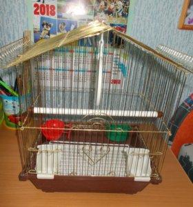 Клетка и игрушки для попугая