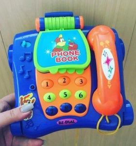 Телефон музыкальный новый