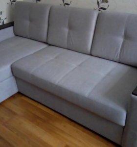Новый угловой диван кровать.