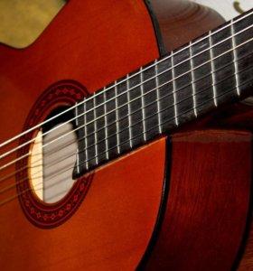 Обучаю игре на гитаре