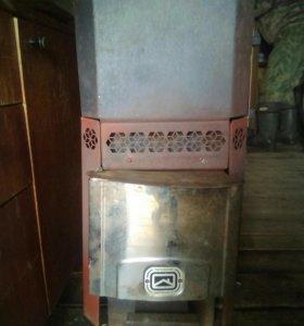 Печь + бак (для бани)и труба с утеплителем.