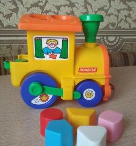 Игрушка паровозик-сортер