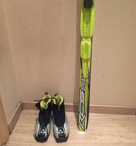 Комплект Fischer : лыжи, лыжные палки и ботинки