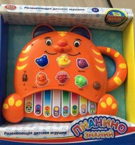 Детская игрушка развивающая музыкальная