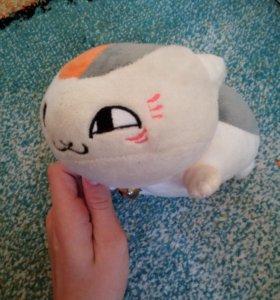 Кот с погремушкой