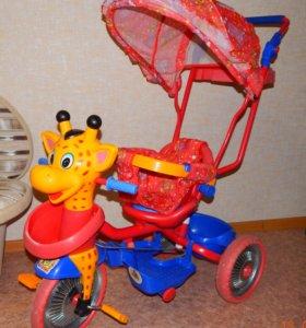 Велосипед трехколесный детский с ручкой.