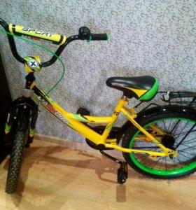 Велосипед дет еще имеються 2 коляса в сзади