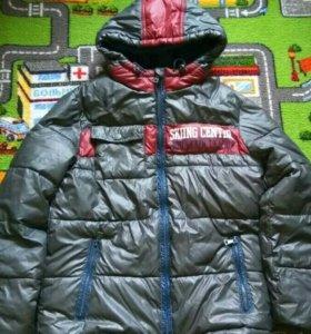 Продам теплую  детскую куртку ACOOLA