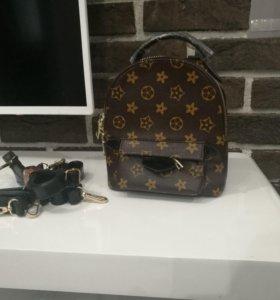 Маленький новый рюкзак