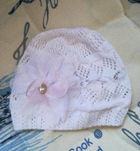Новая вязаная ажурная шапочка