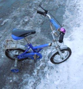 Велосипед с вспомогательными колесиками