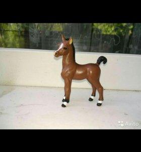 Игрушка маленькая лошадка