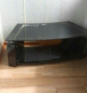Стеклянный стол под телевизор.