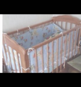Детская кроватка с маятником и ящиком нижним