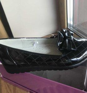 Новые туфли для школьницы