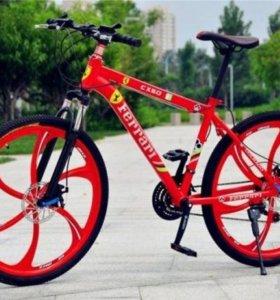 Велосипед на литых дисках Ferrari