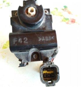 Электрокорректор фары на субару