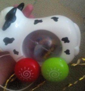Развивающая музыкальная игрушка каталка