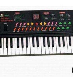 Синтезатор учебный, детский, 54 клавиши. Новый.