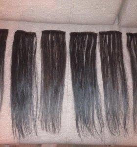Натуральные волосы на заколках.