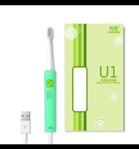 Новая электрическая зубная щётка