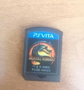 2 диска на PSP Vita: Mortal Comabat, Fifa 14