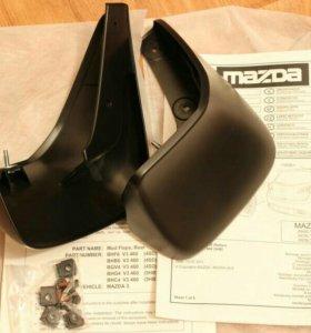 Брызговики задние оригинальные Mazda 3