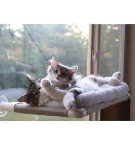Лежанка для кошки на окно