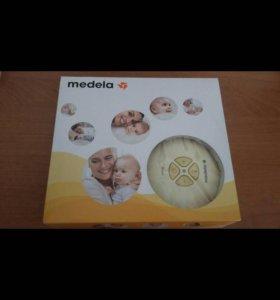 Молокоотсос автоматический Medela