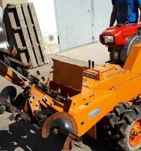 Трактор траншеекопатель