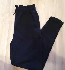 Темно-синие штаны с подворотом р 42-44