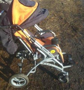 Детская инвалидная коляска для ДЦП