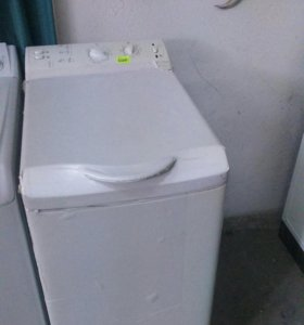 Вертикальная стиральная машина.