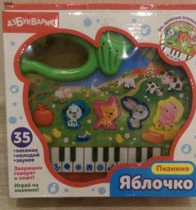 Игрушка яблоко-пианино