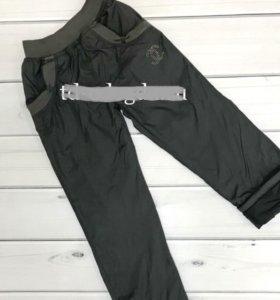 Демисезонные( новые) брюки для девочек т.синие