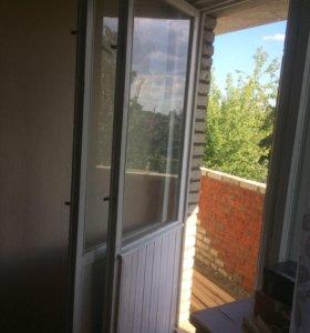 Деревянное окно и балконный блок