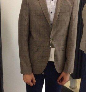 Продам мужской пиджак новый