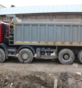 Водитель самосвала Scania