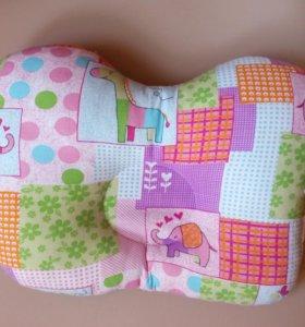 Ортопедическая подушка для младенца.