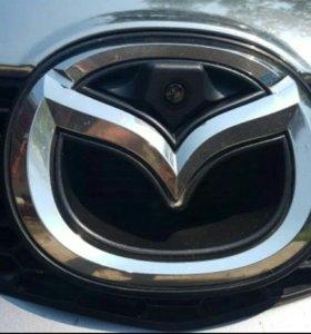 Камера парковки в логотип