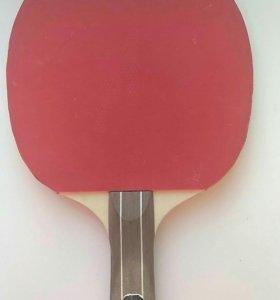 Ракетка для настольного тениса.
