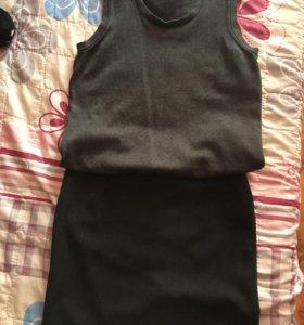На девочку жилетка и юбка