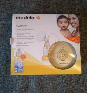 Молокоотсос Medela Swing